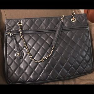 Navy quilted Chanel purse, gold hardware